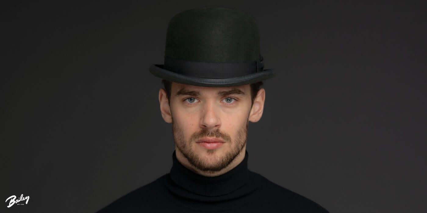A man wearing a bowler hat