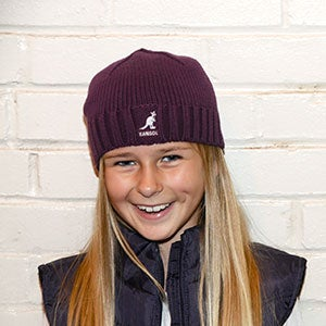 Child Wearing Knit Beanie Cap