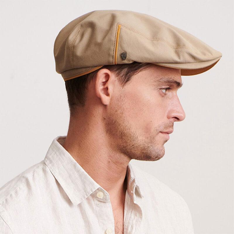 male model wearing beige ivy or flat cap